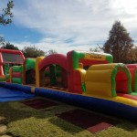 65 foot obstacle course colorful on grass in sunlight outside