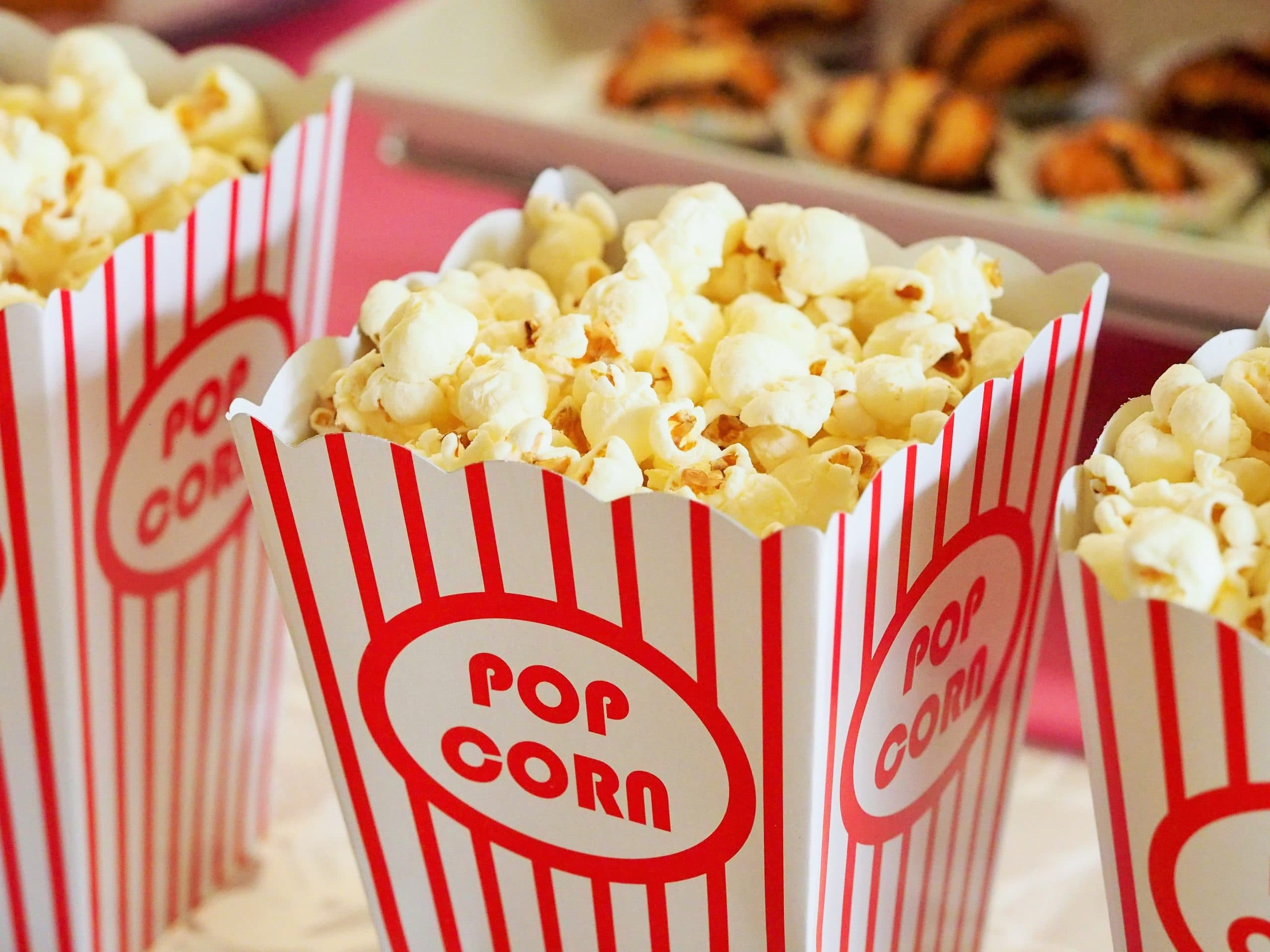 red and white pop corn bag filled with popcorn
