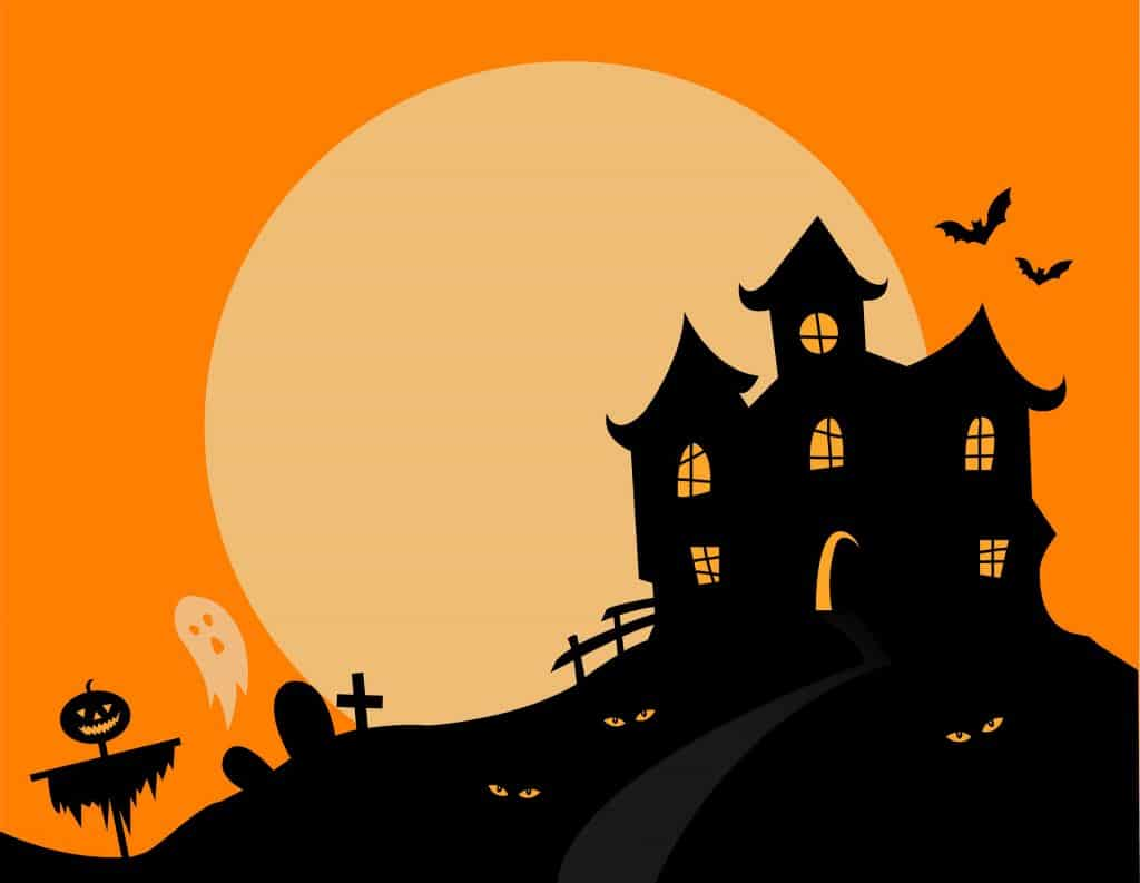 old haunted house sitting on a hill on an orange nigh sky