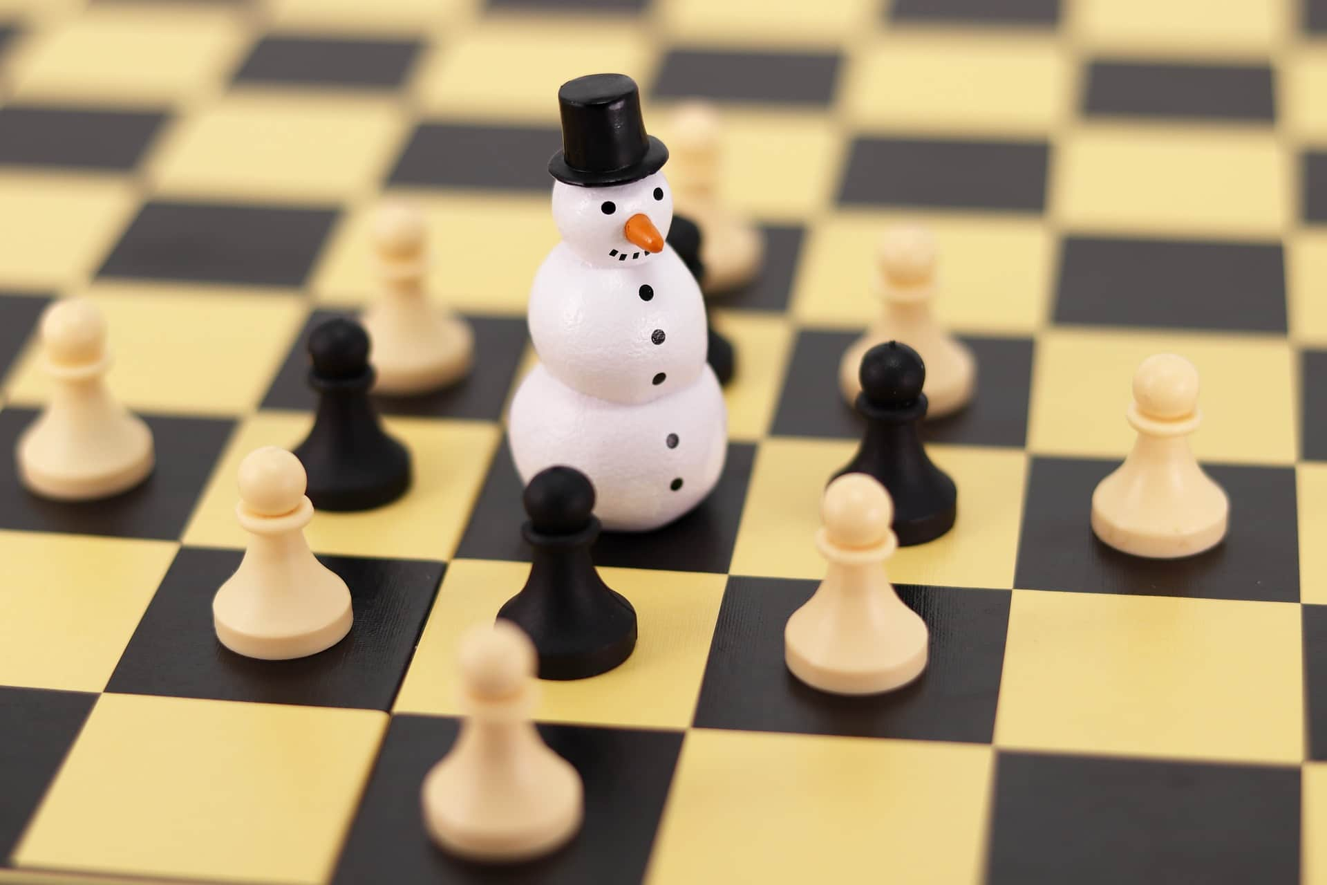 snowman surrounded by chess pieces