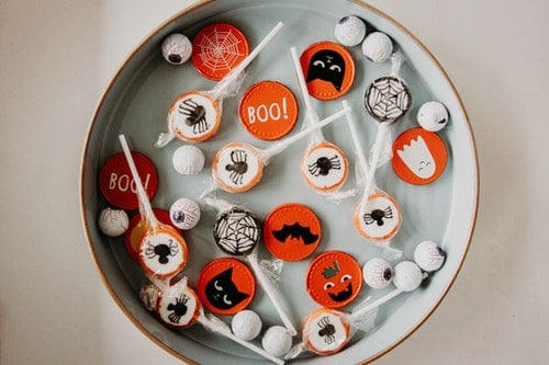 halloween candies and treats in a circular tray