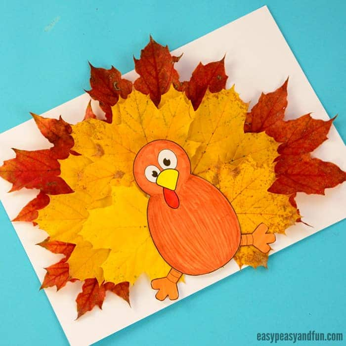 colored paper turkey with leaves for feathers on a blue table