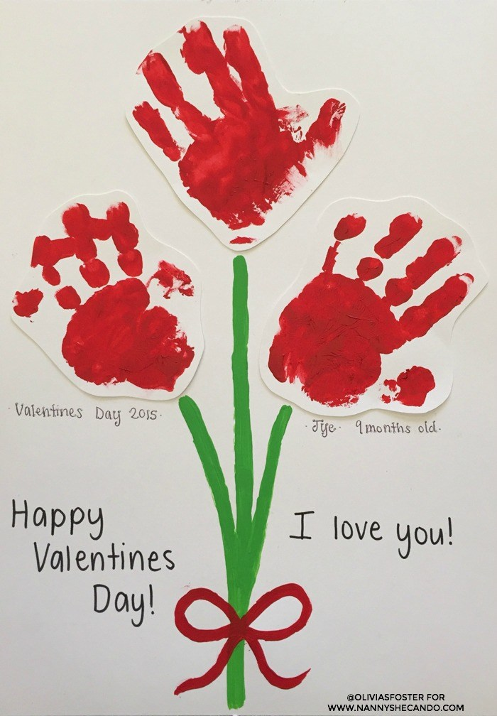"""red handprints of children on a """"bouquet"""" of paint on a paper"""