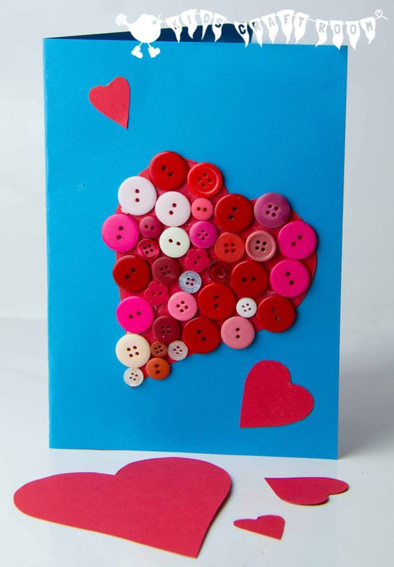 homemade Valnetine's Day card with red white and pink buttons in the shape of a heart