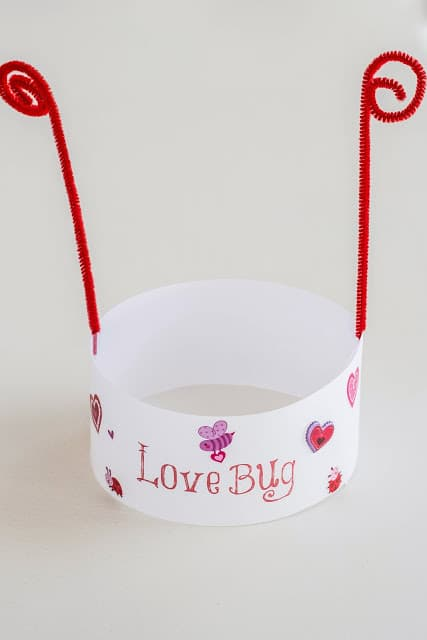 paper hat / headband with red antennas like a lady bug / love bug