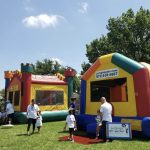 two bounce castles side by side on grass medieval bounce house jump house and colorful jump house