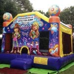 It's a Girl THing bounce house on grass outside front view