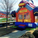 Monster Truck Bounce House rental on a sidewalk