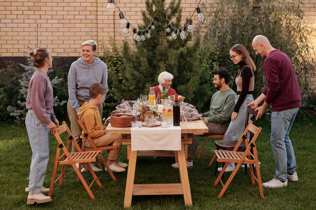 family outside in the backyard getting ready to eat dinner