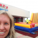 Velcro wall inflatable rental at an event with a kid on it