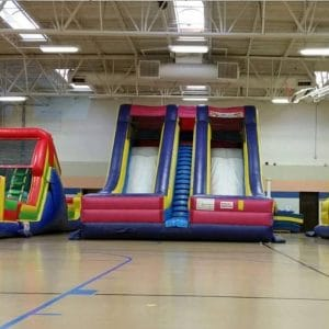 accelerator dry slide inflatable rental in a gym