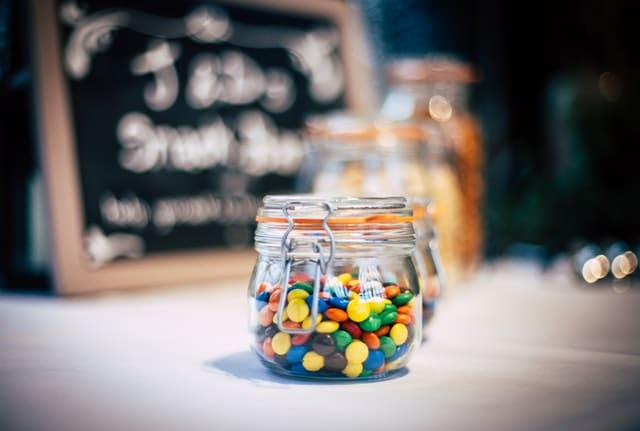 jar of candy pieces on a table
