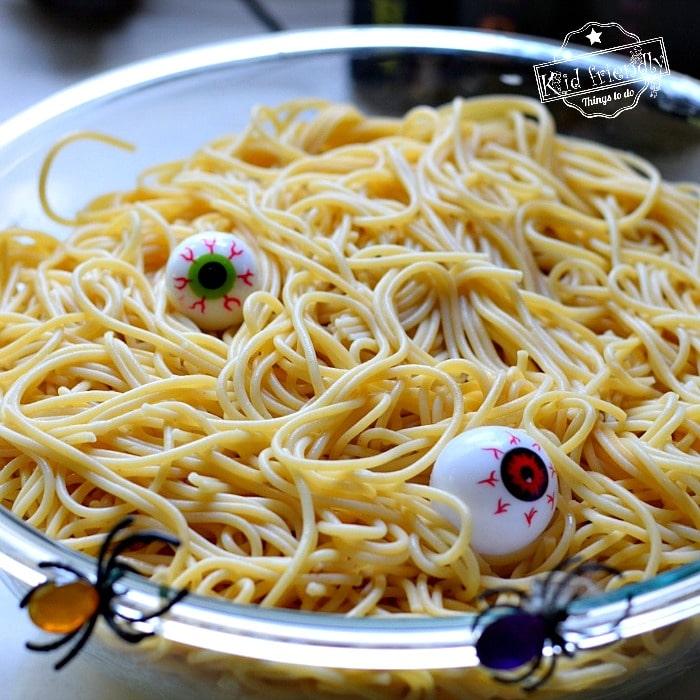 Halloween spaghetti with plastic eyeballs