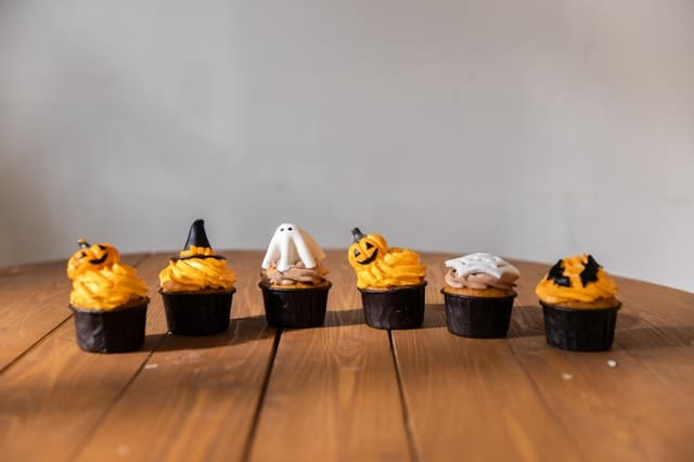 Halloween decorated cupcakes on a wooden table